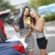 Two woman after shopping - Stock Photo