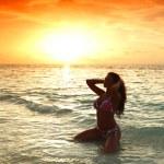 Woman in bikini on beach — Stock Photo #20849105