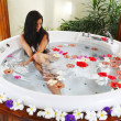 Stock Photo: Pretty womrelaxing in jacuzzi