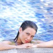 Woman in swimming pool with cocktail — Stock Photo #22232389