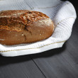 Bread and fabric on black table - Stock Photo