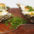 Oysters under cheese and dill — Stock Photo #23278858