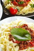 Spaghetti bolognese with basil — Stock Photo