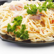 Spaghetti carbonara with fried bacon - Stock Photo
