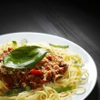 Spaghetti bolognese with basil - Stock Photo