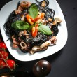 Black spaghetti with seafood - Stock Photo