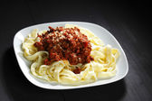 Spaghetti bolognese with parmesan cheese — Stock Photo
