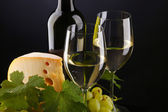 White wine and cheese on black — Stock Photo