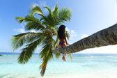 Woman on palm on sea backgroud — Stock Photo
