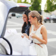 Two woman after shopping — Stock Photo #25922295