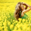 Stock Photo: Womon oilseed field