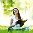 Woman reading book outdoors — Foto de Stock