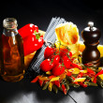 Pasta ingredients on black table — Stock Photo