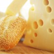 Cheese on a wooden table — Stock Photo #27220513