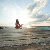 Yoga woman meditating near sea — Stock Photo