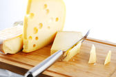 Cheese with a cheese knife — Стоковое фото