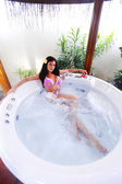 Pretty woman relaxing in jacuzzi — Стоковое фото