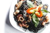 Black spaghetti with seafood — Stock Photo