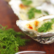 Oysters under cheese and dill — Stock Photo #27831943
