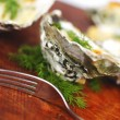 Oysters under cheese and dill — Stock Photo #28606711