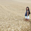 Woman on wheat field — Stock Photo