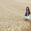Stock Photo: Woman on wheat field