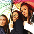 Girlfriends under umbrella — Stock Photo #30400165
