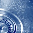 Stock Video: Bubbly flow of water in the sink closeup