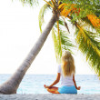 Yoga woman under palm — Stock Photo