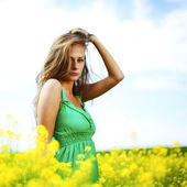 Woman on oilseed field — Stock Photo