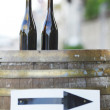 Stock Photo: Wine bottles on wodden barrel
