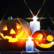 Stock Photo: Halloween pumpkins and candles