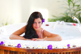 Pretty woman relaxing in jacuzzi — Stock Photo