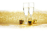 Champagne with christmas present — Stock Photo