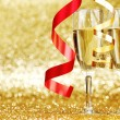 Champagne and ribbons — Stock Photo