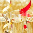 Stock Photo: Champagne and ribbons