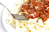 Spaghetti bolognese and fork — Stock Photo