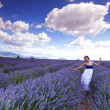 Woman on lavender field — ストック写真