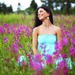 Woman on pink flower field — Stock Photo #33753997