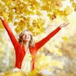 Happy woman in autumn park — Stock Photo #33778257