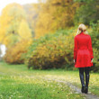 Woman in autumn park — Stock Photo