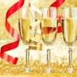 Champagne and ribbons — Stock Photo #33782965