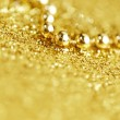 Golden beads — Stock Photo