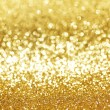 Golden glitter background — Stockfoto