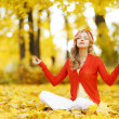 Autumn yoga woman — Fotografia Stock  #34296821