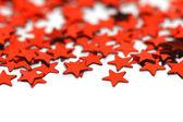 Красные звезды конфетти — Стоковое фото