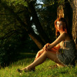 Beautiful young woman in summer forest — Stock Photo