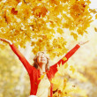 Happy woman in autumn park — Stock Photo #34744749