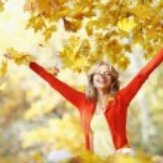 Happy woman in autumn park — Stock Photo #34744771