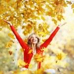 Happy woman in autumn park — Stock Photo #34744803
